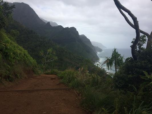 Kalalau Trail on the Na Pali coastline...rich colors, rugged shoreline and incredible views...high surf, severe mountains and beautiful skies... this is perhaps one of the most level and easy to hike portions of the trail. Just a very short portion of the trail that is in the first 2 miles of the trail. A beautiful adventure...