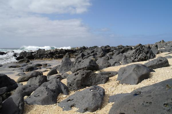 Salt Pond Beach a little further east... black volcanic rocks buried in the sand and warming in the sun...