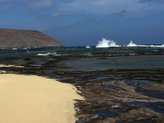 Waves breaking on the reef at Nanina... a beautiful day with sandy beach, volcanic rock, tidal pools, blue sky and Lehua in the distance... it's a magical place...